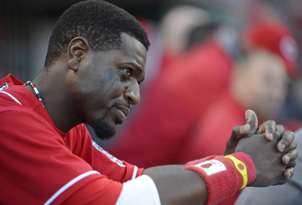 Cincinnati Reds' Brandon Phillips sits in the dugout during Game 4 of the National League division baseball series against the San Francisco Giants, Wednesday, Oct. 10, 2012, in Cincinnati. (AP Photo/Michael Keating)