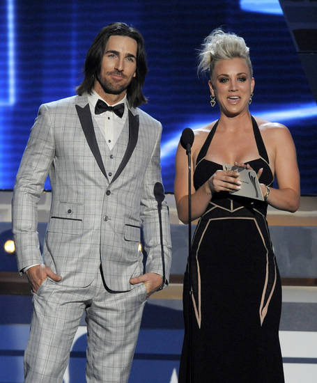 Actress Kaley Cuoco, right, and singer Jake Owen present the award for vocal group of the year at the 48th Annual Academy of Country Music Awards at the MGM Grand Garden Arena in Las Vegas on Sunday, April 7, 2013. (Photo by Chris Pizzello/Invision/AP) ORG XMIT: NVPM271