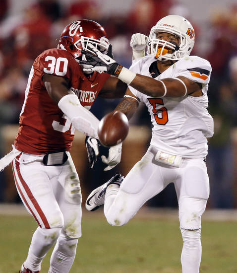 Oklahoma's Javon Harris (30) blocks a pass intended for Oklahoma State's Josh Stewart (5) during the second half of the Bedlam college football game in which  the University of Oklahoma Sooners (OU) defeated the Oklahoma State University Cowboys (OSU) 51-48 in overtime at Gaylord Family-Oklahoma Memorial Stadium in Norman, Okla., Saturday, Nov. 24, 2012. Photo by Steve Sisney, The Oklahoman