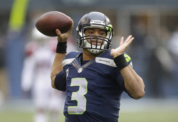 Russell Wilson and the Seattle Seahawks are the odd-on favorites to win the Super Bowl according to MyTopSportsbooks.com. (AP Photo/Elaine Thompson)