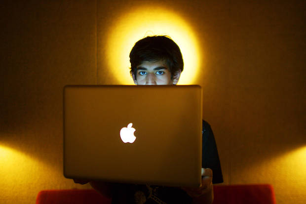 In this Jan. 30, 2009 photo, Internet activist Aaron Swartz poses for a photo in Miami Beach, Fla. Swartz was found dead Friday, Jan. 11, 2013, in his Brooklyn, N.Y., apartment, according to Ellen Borakove, spokeswoman for New York's medical examiner. Swartz, 26, was scheduled to face trial on hacking charges in a few weeks. (AP Photo/The New York Times, Michael Francis McElroy) MANDATORY CREDIT;  NYC OUT;  MAGS OUT; NO SALES; TV OUT,  NO ARCHIVE