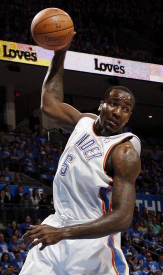 Oklahoma City's Kendrick Perkins (5) grabs a rebound during game one of the first round in the NBA playoffs between the Oklahoma City Thunder and the Dallas Mavericks at Chesapeake Energy Arena in Oklahoma City, Saturday, April 28, 2012. Photo by Nate Billings, The Oklahoman