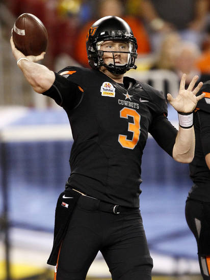Oklahoma State quarterback Brandon Weeden warms up prior to  the Fiesta Bowl NCAA college football game against Stanford, Monday, Jan. 2, 2012, in Glendale, Ariz. (AP Photo/Matt York)