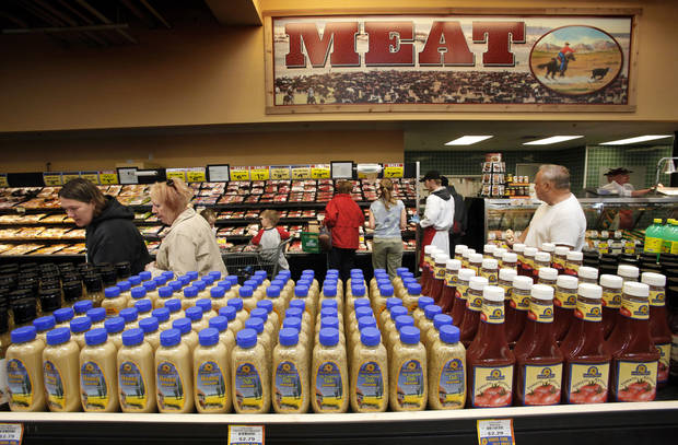 Shoppers are shown next to the meat counter at Sunflower Farmers Market on Second Street in Edmond.
