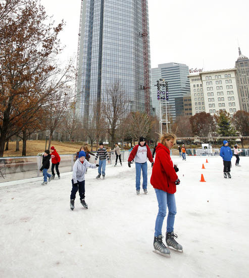 Ice skaters glide on the Devon Ice Rink in 2011 at the Myriad Gardens in downtown Oklahoma City.  Photo by Paul B. Southerland, The Oklahoman Archive