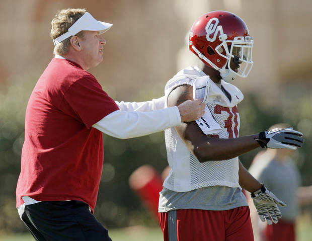 Defensive coordinator Mike Stoops positions Javon Harris (30) during spring football practice for the OU Sooners on the campus of the University of Oklahoma in Norman, Okla., Monday, March 5, 2012. Photo by Nate Billings, The Oklahoman