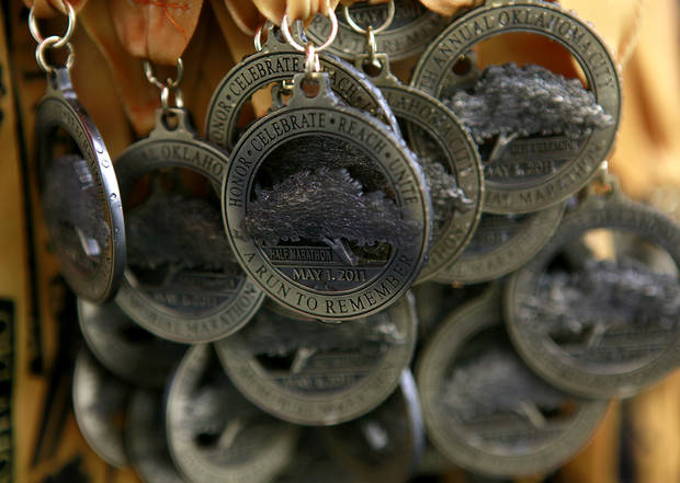 Medals hang at the finish line for participants in the 11th Annual Oklahoma City Memorial Marathon in Oklahoma City on Sunday, May 1, 2011. Photo by John Clanton, The Oklahoman