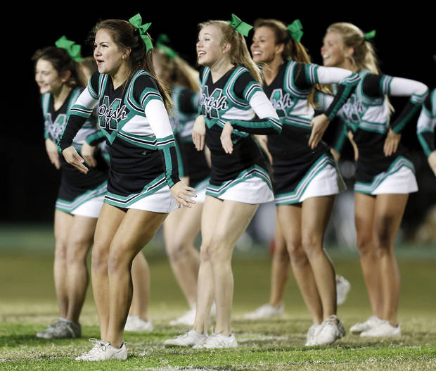 The Bishop McGuinness cheerleaders perform during a high school football game between Bishop McGuinness and Guthrie at Bishop McGuinness Catholic High School in Oklahoma City, Friday, Oct. 26, 2012. Photo by Nate Billings, The Oklahoman