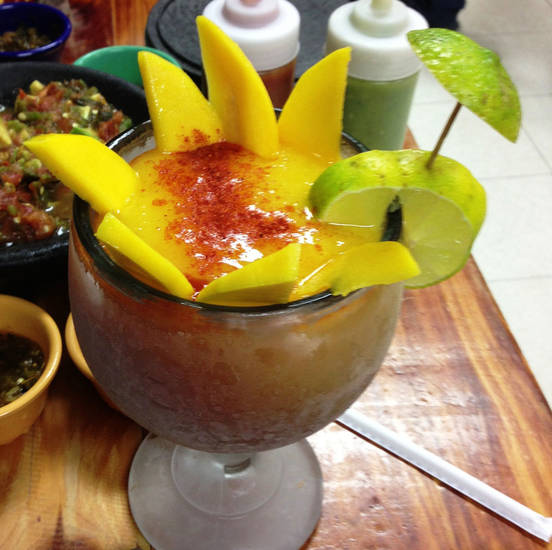 Chef Santos Flores offers mango smoothies with Salsa Chamoy at Abel's Mexican Restaurant in Warr Acres. <strong>DAVE CATHEY - THE OKLAHOMAN</strong>