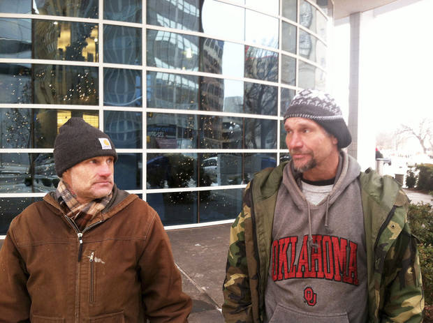 Charles Scott, left, and Jeff Hancock, who are homeless, talk Friday outside the Ronald J. Norick Downtown Library. Photo by Phillip O�Connor, The Oklahoman