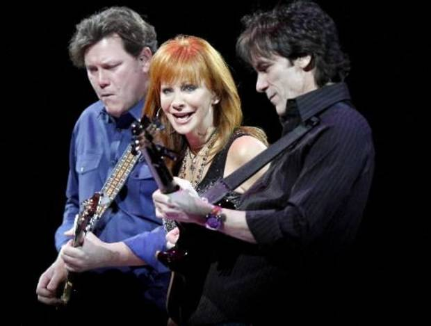 Reba performs with her excellent band.