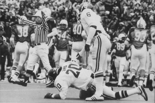 OU QUARTERBACK THOMAS LOTT REACHES DOWN TO HELP BILLY SIMS TO HIS FEET AFTER SIMS DROPPED THE FIRST OF HIS TWO FUMBLES  IN GAME VS NEBRASKA ON 11/12/78 (Original photo ran 11/13/78 TIMES)