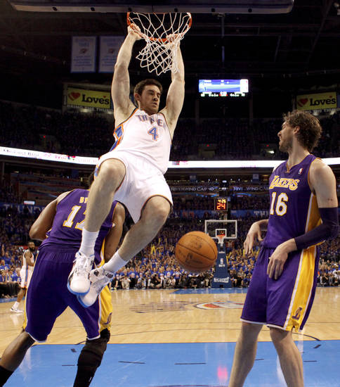 Oklahoma City's Nick Collison (4) dunks the ball between Los Angeles' Andrew Bynum (17), and Los Angeles' Pau Gasol (16) during Game 5 in the second round of the NBA playoffs between the Oklahoma City Thunder and the L.A. Lakers at Chesapeake Energy Arena in Oklahoma City, Monday, May 21, 2012. Oklahoma City won 106-90.  Photo by Bryan Terry, The Oklahoman