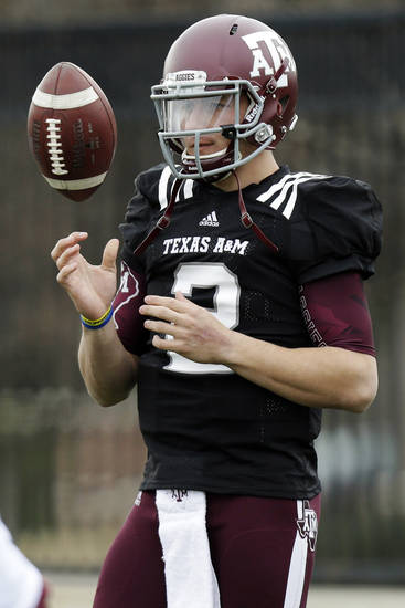 Texas A&M quarterback Johnny Manziel (2) tosses a ball during practice for the Cotton Bowl NCAA college football game, Sunday, Dec. 30, 2012, in Dallas. Texas A&M is scheduled to play Oklahoma on Jan. 4, 2013. (AP Photo/LM Otero) ORG XMIT: TXMO113