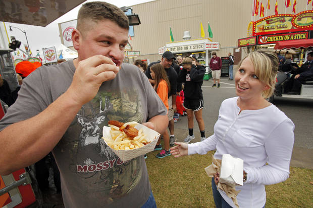Patrick Jarrels, Lindsay, samples batter fried bacon as Billea Taylor watches during the 106th Oklahoma State Fair at State Fair Park on Saturday, Sept. 15, 2012, in Oklahoma City, Okla.  Photo by Steve Sisney, The Oklahoman
