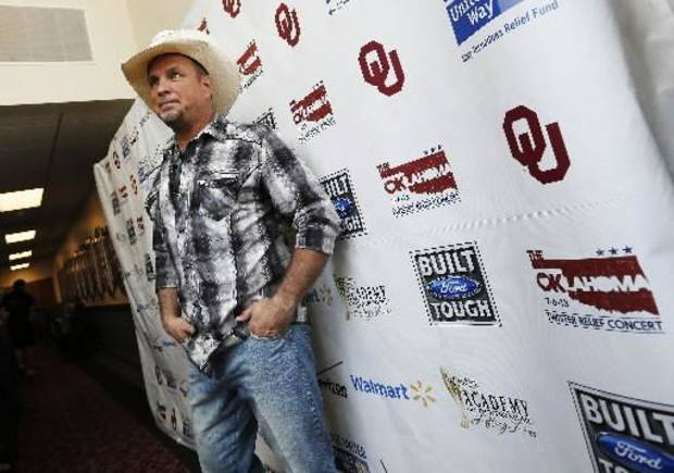 Garth Brooks poses for photographers backstage during the Oklahoma Twister Relief Concert, benefiting victims of the May tornadoes, at Gaylord Family - Oklahoma Memorial Stadium on the campus of the University of Oklahoma in Norman, Okla., Saturday, July 6, 2013. Photo by Nate Billings, The Oklahoman