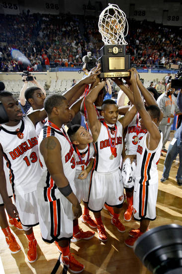 CLASS 4A HIGH SCHOOL BASKETBALL / STATE TOURNAMENT: The Douglass team lifts the trophy after their 86-53 win over Anadarko in the Class 4A boys high school state basketball championship game at State Fair Arena in Oklahoma City, Saturday, March 10, 2012. Photo by Bryan Terry, The Oklahoman
