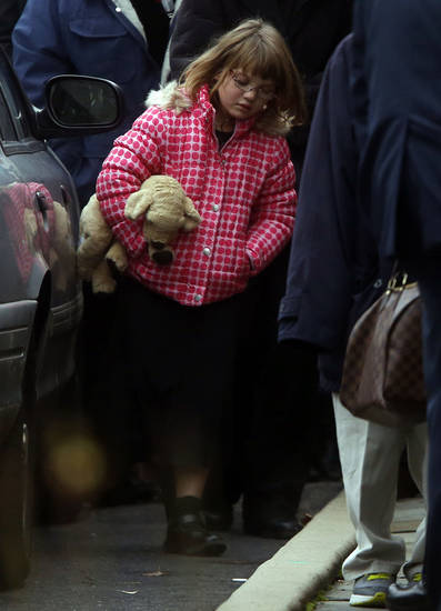 Mourners leave after a funeral service for Noah Pozner, 6,  Monday, Dec. 17, 2012, in Fairfield, Conn.  Pozner was killed when a gunman walked into Sandy Hook Elementary School in Newtown Friday and opened fire, killing 26 people, including 20 children. (AP Photo/Jason DeCrow) ORG XMIT: CTJD117