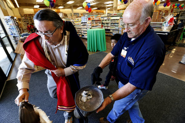 Store manager Ron Green holds hot coals as Charles Haag, a Southern Cheyenne tribal member, conducts a blessing ceremony in the new Sprouts Farmers Market in Norman. PHOTO BY STEVE SISNEY, THE OKLAHOMAN <strong>STEVE SISNEY</strong>