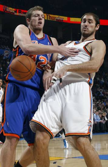 David Lee (42) of New York collides with Nenad Krstic (12) of Oklahoma City during the NBA basketball game between the Oklahoma City Thunder and the New York Knicks at the Ford Center in Oklahoma City, January 11, 2010. Photo by Nate Billings, The Oklahoman