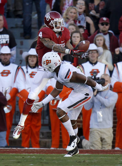 Kenny Stills (4) catches a touchdown pass in front of Oklahoma State's Justin Gilbert (4) during the Bedlam college football game between the University of Oklahoma Sooners (OU) and the Oklahoma State University Cowboys (OSU) at Gaylord Family-Oklahoma Memorial Stadium in Norman, Okla., Saturday, Nov. 24, 2012. Photo by Bryan Terry, The Oklahoman