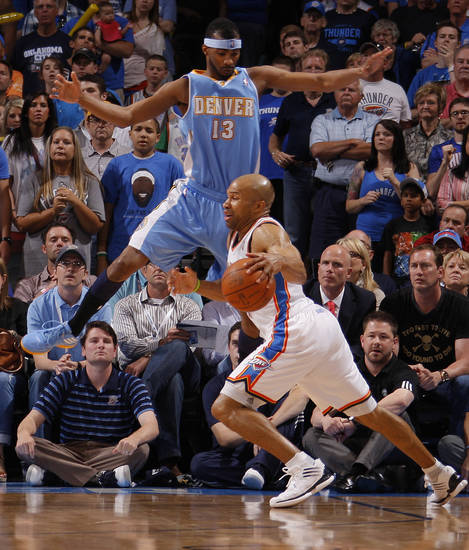 Oklahoma City's Derek Fisher (37) goes past Denver's Corey Brewer (13) during the NBA basketball game between the Oklahoma City Thunder and the Denver Nuggets at Chesapeake Energy Arena in Oklahoma City, Wednesday, April 25, 2012. Oklahoma City lost 106-101.  Photo by Bryan Terry, The Oklahoman