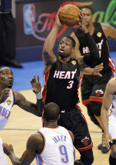 Miami's Dwyane Wade (3) shoots over Oklahoma City's Serge Ibaka (9) during Game 2 of the NBA Finals between the Oklahoma City Thunder and the Miami Heat at Chesapeake Energy Arena in Oklahoma City, Thursday, June 14, 2012. Photo by Chris Landsberger, The Oklahoman