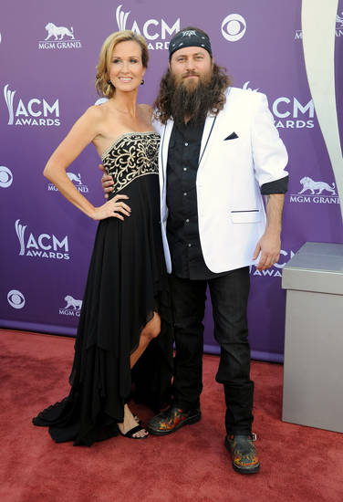 TV personalities Korie Robertson, left, and Willie Robertson arrive at the 48th Annual Academy of Country Music Awards at the MGM Grand Garden Arena in Las Vegas on Sunday, April 7, 2013. (Photo by Al Powers/Invision/AP) ORG XMIT: NVPM244