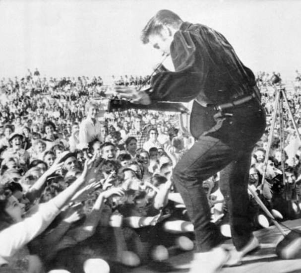 "Elvis Presley performs in Tupelo, Miss. in Sept., 1956. That year, Presley had a No. 1 hit with ""Heartbreak Hotel."" (AP Photo/file)"