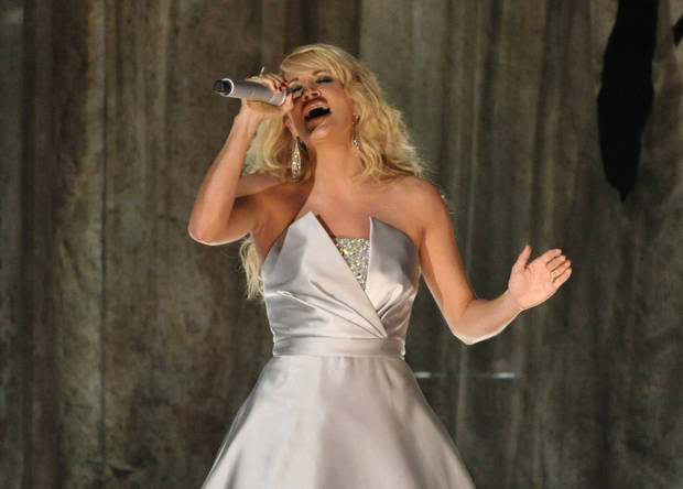 Carrie Underwood performs on stage at the 55th annual Grammy Awards on Sunday, Feb. 10, 2013, in Los Angeles. (Photo by John Shearer/Invision/AP) ORG XMIT: CAAR215