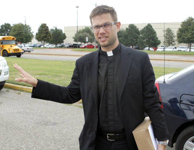 Oklahoma City clergyman Lance Schmitz holds petitions that he attempted to deliver to Hobby Lobby&#039;s corporate headquarters Thursday in Oklahoma City.