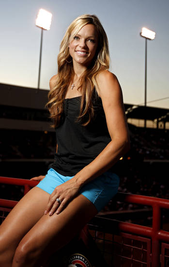 Jennie Finch poses for a portrait before the Oklahoma City RedHawks against the Round Rock Express at the AT&T Bricktown Ballpark in Oklahoma City, Tuesday, June 23, 2009. Photo by Bryan Terry, The Oklahoman