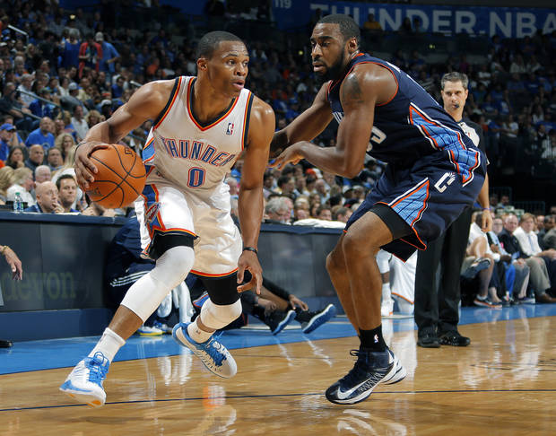 Oklahoma City's Russell Westbrook (0) tries to get by Charlotte's Reggie Williams (55) during the preseason NBA game between the Oklahoma City Thunder and the Charlotte Bobcats at Chesapeake Energy Arena in Oklahoma City, Tuesday, Oct. 16, 2012. Photo by Sarah Phipps, The Oklahoman