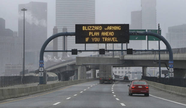 A warning sign flashes for motorists on the expressway into Boston as snow starts to fall on Friday, Feb. 8, 2013. A major winter storm is heading toward the U.S. Northeast with up to 2 feet of snow expected for a Boston-area region that has seen mostly bare ground this winter. (AP Photo/Elise Amendola) ORG XMIT: MAEA102