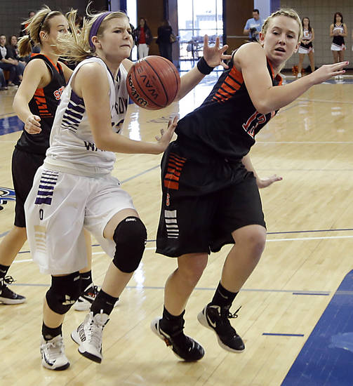 Okarche's Kenadey Grellner (22) drives past Sterling's Laurie Derrico (13) during the Class A girls state quarterfinal game between Okarche and Sterling at Oklahoma City University on Thursday, Feb. 28, 2013, in Oklahoma City, Okla. Photo by Chris Landsberger, The Oklahoman