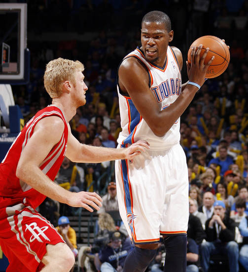 Oklahoma City's Kevin Durant (35) keeps the ball away from Chase Budinger (10) of Houston in the second half during the NBA basketball game between the Oklahoma City Thunder and the Houston Rockets at Chesapeake Energy Arena in Oklahoma City, Friday, Jan. 6, 2012. The Thunder won, 109-94. Photo by Nate Billings, The Oklahoman