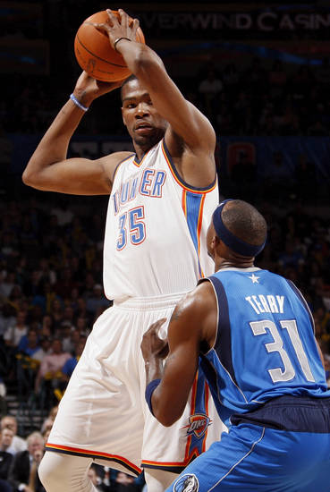 Oklahoma City's Kevin Durant (35) keeps the ball away from Dallas' Jason Terry (31) during the NBA basketball game between the Oklahoma City Thunder and the Dallas Mavericks at Chesapeake Energy Arena in Oklahoma City, Monday, March 5, 2012. The Thunder won, 95-91. Photo by Nate Billings, The Oklahoman