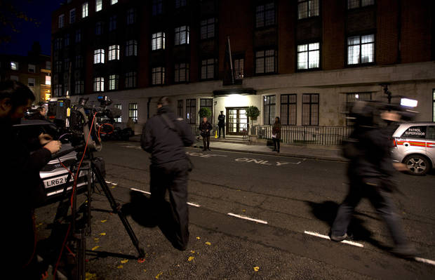 "Members of the media position themselves, as a policeman stands guard outside the King Edward VII hospital where the Duchess of Cambridge has been admitted with a severe form of morning sickness,  in London, Monday, Dec.  3, 2012. Prince William and his wife Kate are expecting their first child. St. James's Palace announced the pregnancy Monday, saying that the Duchess of Cambridge � formerly known as Kate Middleton � has a severe form of morning sickness and is currently in a London hospital. William is at his wife's side. The palace said since the pregnancy is in its ""very early stages,"" the 30-year-old duchess is expected to stay in the hospital for several days and will require a period of rest afterward. (AP Photo/Alastair Grant)"