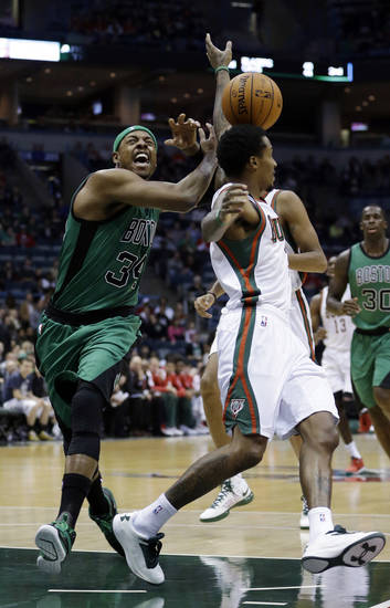 Boston Celtics' Paul Pierce (34) is fouled by Milwaukee Bucks' Brandon Jennings while going up for a shot during the first half of an NBA basketball game on Saturday, Dec. 1, 2012, in Milwaukee. (AP Photo/Morry Gash)