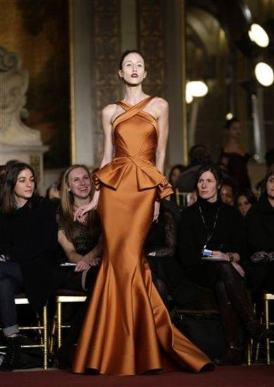 A model walks the runway during the Zac Posen Fall 2013 runway show at Fashion Week at the Plaza in New York, Sunday, Feb. 10, 2013.  (AP Photo/Kathy Willens)