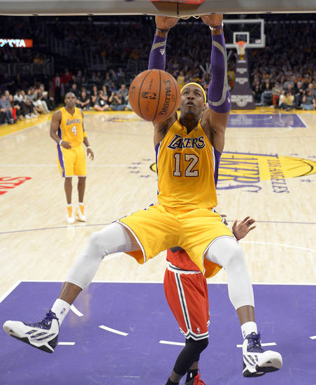 Los Angeles Lakers center Dwight Howard dunks during the second half of their NBA basketball game against the Milwaukee Bucks, Tuesday, Jan. 15, 2013, in Los Angeles. The Lakers won 104-88. (AP Photo/Mark J. Terrill)