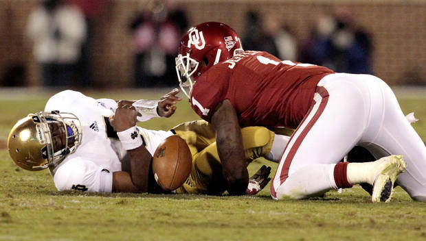 Oklahoma defensive back Tony Jefferson (1) tackles Notre Dame quarterback Everett Golson (5) and the ball comes lose during the second half of the college football game where the University of Oklahoma Sooners (OU) were defeated by the Fighting Irish of Notre Dame (ND) 30-13 at Gaylord Family-Oklahoma Memorial Stadium in Norman, Okla., on Saturday, Oct. 27, 2012. The player was ruled down.  Photo by Steve Sisney, The Oklahoman