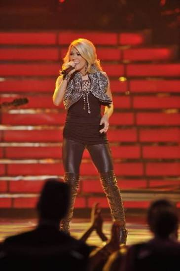 "In this publicity image released by Fox, Season four American Idol Carrie Underwood performs during the "" American Idol"" finale at the Nokia Theatre in Los Angeles."