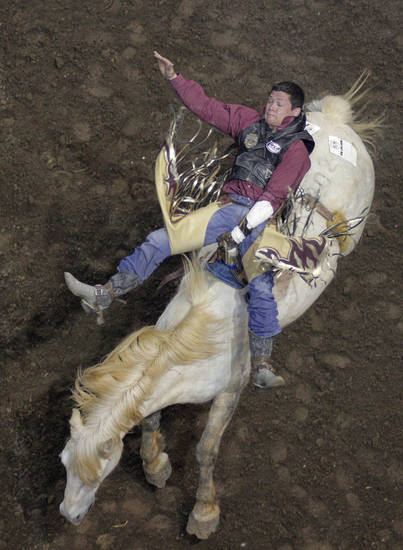 Tanner Aus, of Granite Falls, Minn., competes in bareback riding during the Ram National Circuit Finals Rodeo Championship in Oklahoma City, Sunday, April 1, 2012.  Photo by Garett Fisbeck, For The Oklahoman