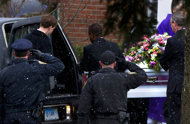 Police salute as the casket of Josephine Gay is loaded into a hearse after funeral services at St. Rose of Lima Roman Catholic Church, Saturday, Dec. 22, 2012, in Newtown. Gay, was one of 20 children and six adult victims killed in on the Dec. 14 mass shooting at Sandy Hook Elementary in Newtown.  (AP Photo/The News-Times, Cody Duty) MANDATORY CREDITCREDIT