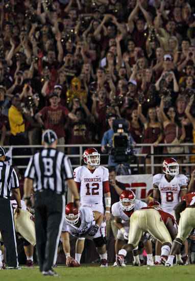 The Florida State crowd cheers as Oklahoma's Landry Jones (12) gets ready for the play during a college football game between the University of Oklahoma (OU) and Florida State (FSU) at Doak Campbell Stadium in Tallahassee, Fla., Saturday, Sept. 17, 2011. Oklahoma won 23-13. Photo by Bryan Terry, The Oklahoman