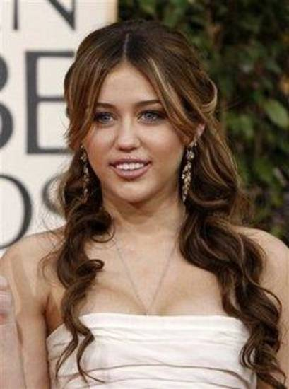 ** FILE ** In this Jan. 11, 2009 file photo, Miley Cyrus arrives at the 66th Annual Golden Globe Awards in Beverly Hills, Calif. (AP Photo/Matt Sayles, file)