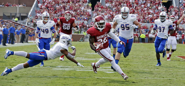 Oklahoma's Roy Finch (22) scores during the first half of a college football game between the University of Oklahoma Sooners (OU) and the Tulsa Golden Hurricane (TU) at Gaylord Family-Oklahoma Memorial Stadium in Norman, Okla., on Saturday, Sept. 14, 2013. Photo by Steve Sisney, The Oklahoman