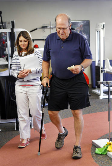 Maj. John Waldenville, is seen during rehab therapy with occupational therapist Jennifer Curry at Jim Thorpe North on Thursday.  Photo by Jim Beckel, The Oklahoman