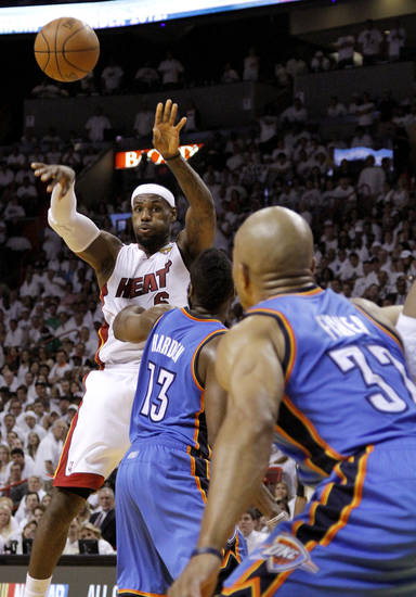 Miami's LeBron James (6) passes the ball over Oklahoma City's James Harden (13) during Game 3 of the NBA Finals between the Oklahoma City Thunder and the Miami Heat at American Airlines Arena, Sunday, June 17, 2012. Photo by Bryan Terry, The Oklahoman